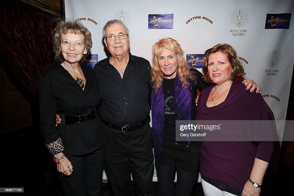 Sherry Johnson, Garry Johnson, author and photographer Lisa Johnson and Colette Johnson attend the book launch and performance for '108 Rock Star Guitars' benefitting The Les Paul Foundation at The Cutting Room on October 8, 2013 in New York City.