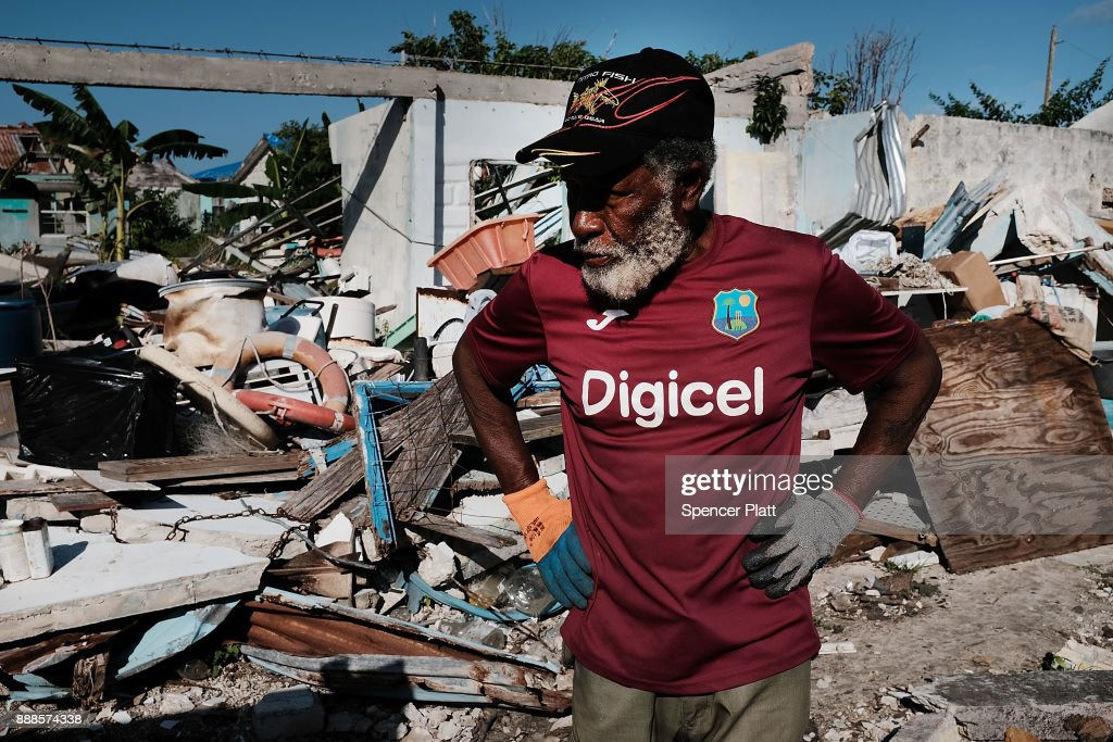 Sherwan Webber stands amongst the debris of his home on the nearly destroyed island of Barbuda on December 8, 2017 in Cordington, Barbuda. Barbuda, which covers only 62 square miles, was nearly leveled when Hurricane Irma made landfall with 185mph winds on the night of September six. Only two days later, fearing Barbuda would be hit again by Hurricane Jose, the prime minister ordered an evacuation of all 1,800 residents of the island. Most are now still in shelters scattered around Barbuda's much larger sister island Antigua.