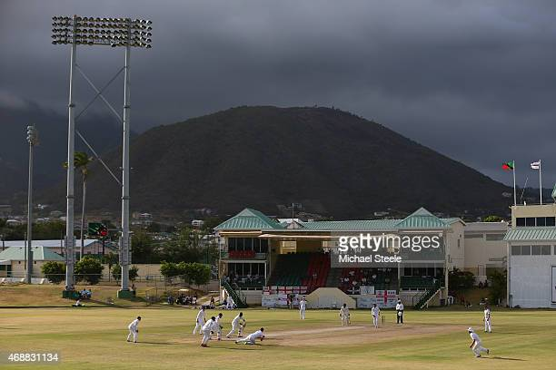 Sherwin Peters of St Kitts bats as Alastair Cook of England fields at slip of the bowling of Adil Rashid during day two of the St Kitts and Nevis...