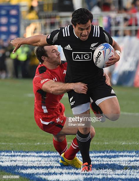 Sherwin Stowers of New Zealand is tackled by Will Harries of Wales during the USA Sevens Rugby tournament at Sam Boyd Stadium on February 13 2015 in...