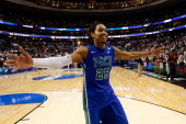 Sherwood Brown of the Florida Gulf Coast Eagles celebrates after they won 7868 against the Georgetown Hoyas during the second round of the 2013 NCAA...