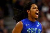 Sherwood Brown of the Florida Gulf Coast Eagles reacts in the second half against the Georgetown Hoyas during the second round of the 2013 NCAA Men's...