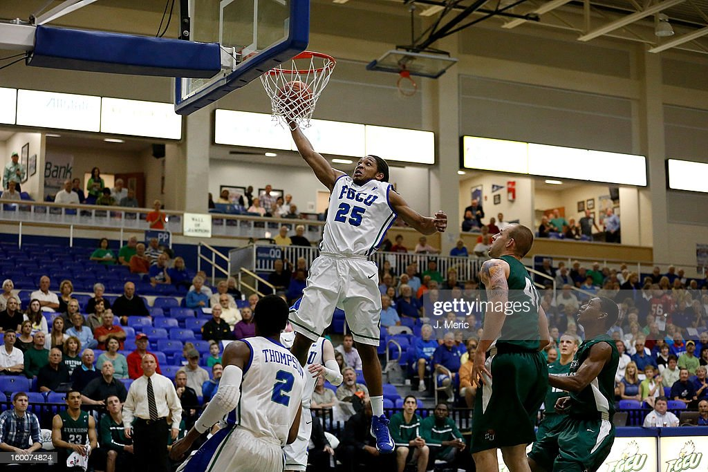 Sherwood Brown #25 of the Florida Gulf Coast University Eagles drives to the basket against the Stetson Hatters during the game at Alico Arena on January 25, 2013 in Ft. Myers, Florida.