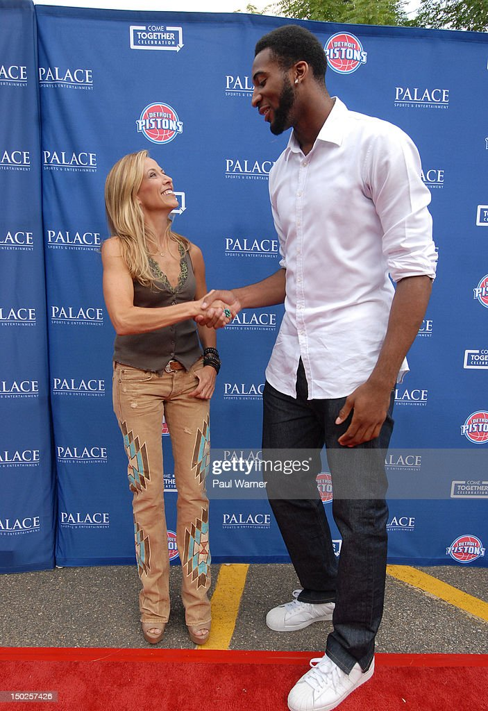 Sheryl Crow (L) and Detroit Piston Andre Drummond attend the Palace Sports and Entertainment's Come Together Celebration concert at the DTE Energy Music Theater on August 12, 2012 in Clarkston, Michigan.