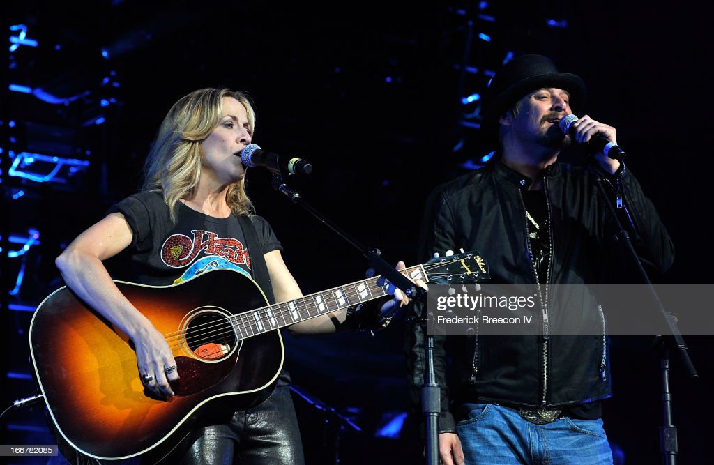 <a gi-track='captionPersonalityLinkClicked' href=/galleries/search?phrase=Sheryl+Crow&family=editorial&specificpeople=201867 ng-click='$event.stopPropagation()'>Sheryl Crow</a> and <a gi-track='captionPersonalityLinkClicked' href=/galleries/search?phrase=Kid+Rock&family=editorial&specificpeople=171123 ng-click='$event.stopPropagation()'>Kid Rock</a> perform during Keith Urban's Fourth annual We're All For The Hall benefit concert at Bridgestone Arena on April 16, 2013 in Nashville, Tennessee.