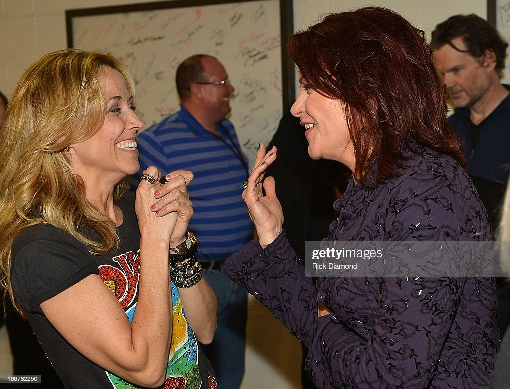 Sheryl Crow and Rosanne Cash backstage during Keith Urban's Fourth annual We're All For The Hall benefit concert at Bridgestone Arena on April 16, 2013 in Nashville, Tennessee.