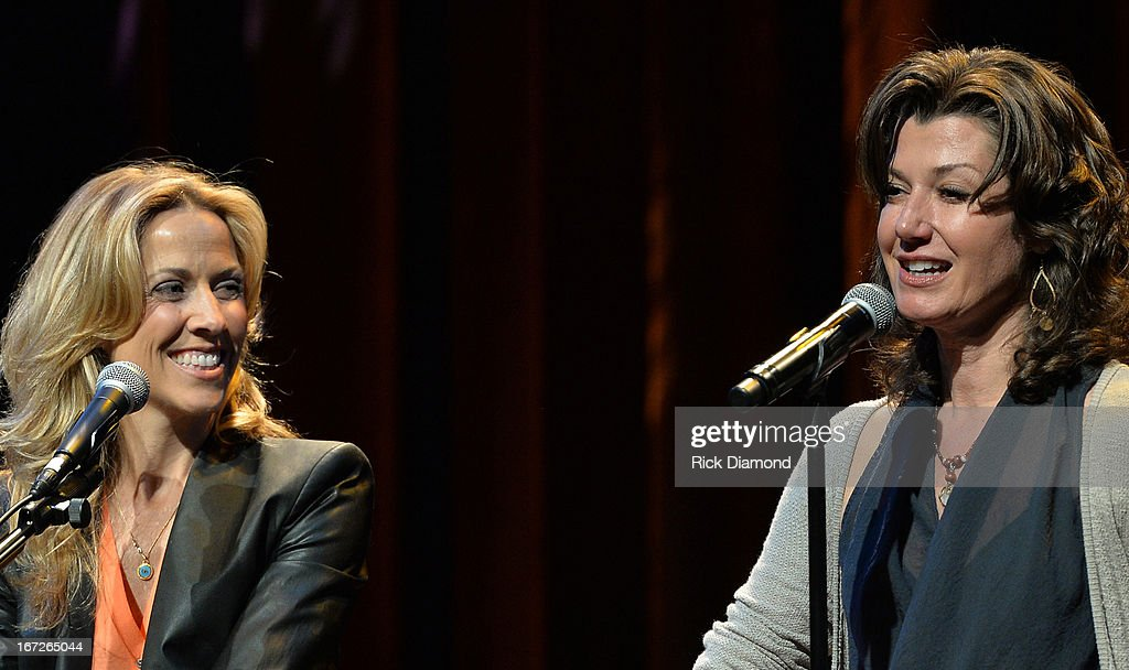 Sheryl Crow is joined by <a gi-track='captionPersonalityLinkClicked' href=/galleries/search?phrase=Amy+Grant&family=editorial&specificpeople=240521 ng-click='$event.stopPropagation()'>Amy Grant</a> to perform at 'An Evening with Sheryl Crow' to benefit New Hope Academy at The Franklin Theater on April 21, 2013 in Franklin, Tennessee.