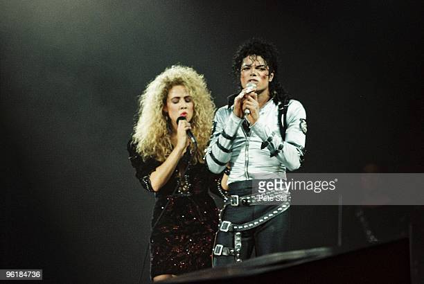 Sheryl Crow joins Michael Jackson to perform on stage on his BAD tour at Wembley Stadium on July 3rd 1988 in London United Kingdom