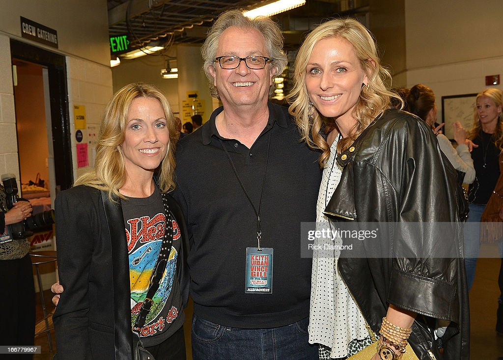 Sheryl Crow, Kyle Young, and Jamie Tisch are backstage during Keith Urban's Fourth annual We're All For The Hall benefit concert at Bridgestone Arena on April 16, 2013 in Nashville, Tennessee.
