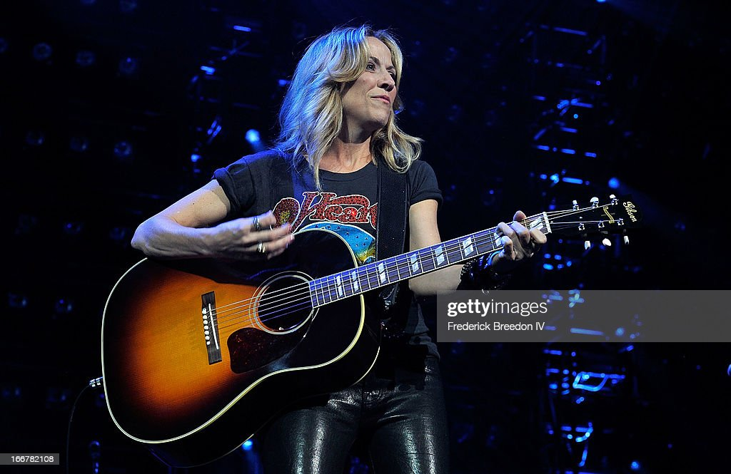 Sheryl Crow performs during Keith Urban's Fourth annual We're All For The Hall benefit concert at Bridgestone Arena on April 16, 2013 in Nashville, Tennessee.