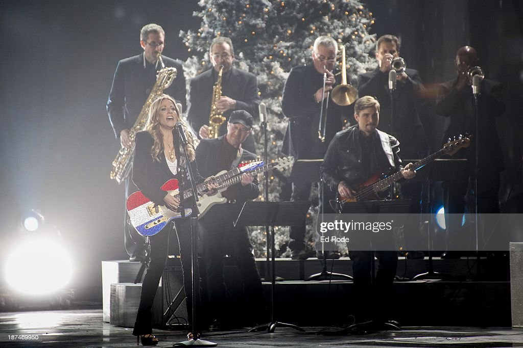 <a gi-track='captionPersonalityLinkClicked' href=/galleries/search?phrase=Sheryl+Crow&family=editorial&specificpeople=201867 ng-click='$event.stopPropagation()'>Sheryl Crow</a> performs during the CMA 2013 Country Christmas on November 8, 2013 in Nashville, Tennessee.