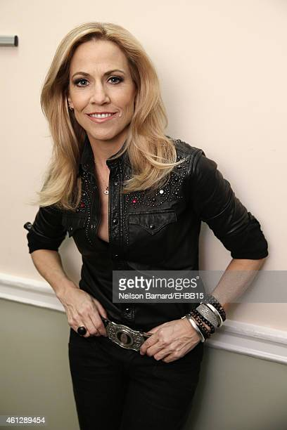 Sheryl Crow poses backstage at The Life Songs of Emmylou Harris An All Star Concert Celebration at DAR Constitution Hall on January 10 2015 in...
