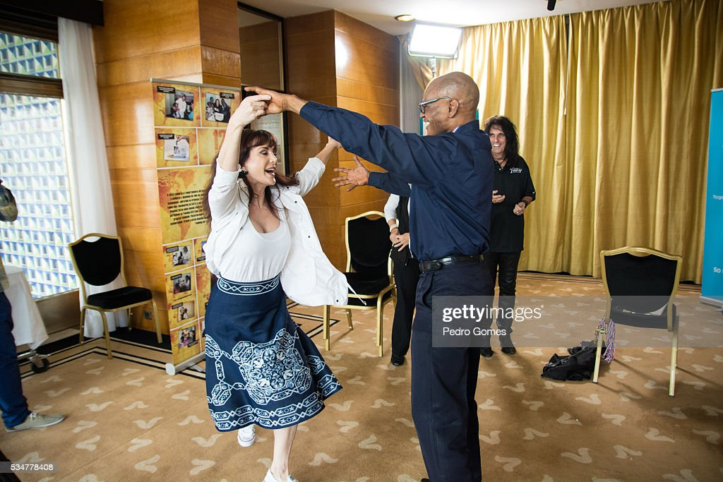 Sheryl Goddard dances with a patient of the Starkey Hearing Foundation at Four Season Hotel Ritz Lisbon on May 27, 2016 in Lisbon, Portugal.