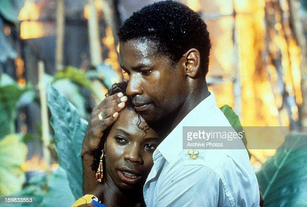 Sheryl Lee Ralph is held by Denzel Washington in a scene from the film 'The Mighty Quinn' 1989