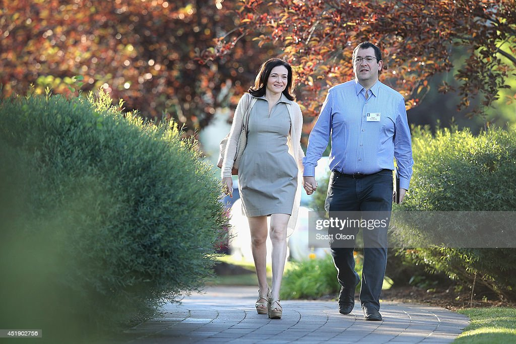 <a gi-track='captionPersonalityLinkClicked' href=/galleries/search?phrase=Sheryl+Sandberg&family=editorial&specificpeople=5922850 ng-click='$event.stopPropagation()'>Sheryl Sandberg</a>, chief operating officer (COO) of Facebook, and her husband <a gi-track='captionPersonalityLinkClicked' href=/galleries/search?phrase=David+Goldberg+-+Surveymonkey+CEO&family=editorial&specificpeople=14572741 ng-click='$event.stopPropagation()'>David Goldberg</a>, CEO of SurveyMonkey, attend the Allen & Company Sun Valley Conference on July 9, 2014 in Sun Valley, Idaho. Many of the worlds wealthiest and most powerful businessmen from media, finance, and technology attend the annual week-long conference which is in its 32nd year.