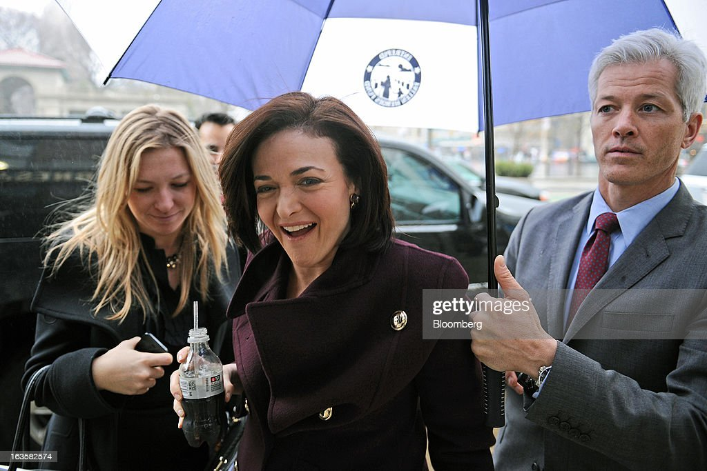<a gi-track='captionPersonalityLinkClicked' href=/galleries/search?phrase=Sheryl+Sandberg&family=editorial&specificpeople=5922850 ng-click='$event.stopPropagation()'>Sheryl Sandberg</a>, chief operating officer of Facebook Inc., center, arrives at a Barnes & Noble Inc. store to speak about her new book 'Lean In' in New York, U.S., on Tuesday, March 12, 2013. Sandberg's book, released on March 11, advises women to get over their ambivalence about being ambitious, think big and take risks. Photographer: Peter Foley/Bloomberg via Getty Images