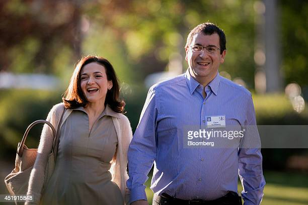 Sheryl Sandberg chief operating officer of Facebook Inc left and her husband David 'Dave' Goldberg chief executive officer of SurveyMonkey arrive to...