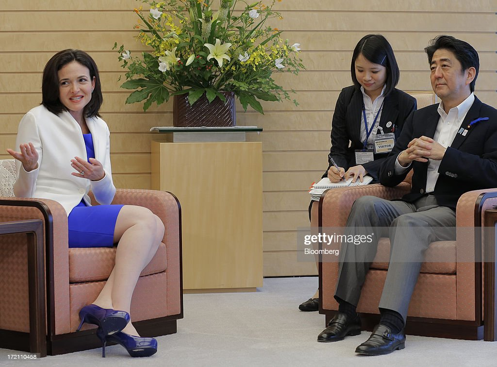 Sheryl Sandberg, chief operating officer of Facebook Inc., left, gestures as she speaks with Shinzo Abe, Japan's prime minister, right, during their meeting at the prime minister's official residence in Tokyo, Japan, on Tuesday, July 2, 2013. Sandberg is in Japan to promote her book 'Lean In: Women, Work, and the Will to Lead.' Photographer: Itsuo Inouye/Pool via Bloomberg