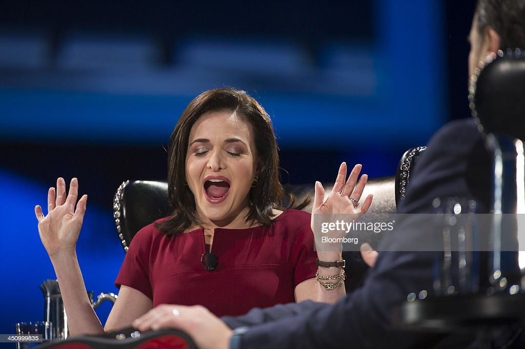Sheryl Sandberg, chief operating officer of Facebook Inc., left, reacts while speaking with Marc Benioff, chairman and chief executive officer of Salesforce.com Inc., during the DreamForce Conference in San Francisco, California, U.S., on Wednesday, Nov. 20, 2013. Salesforce.com Inc. introduced an overhauled version of its mobile software, seeking to ensure clients and partners will be able to use more features of the company's sales, marketing and customer service software. Photographer: David Paul Morris/Bloomberg via Getty Images