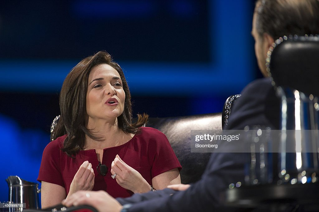 Sheryl Sandberg, chief operating officer of Facebook Inc., left, speaks with Marc Benioff, chairman and chief executive officer of Salesforce.com Inc., during the DreamForce Conference in San Francisco, California, U.S., on Wednesday, Nov. 20, 2013. Salesforce.com Inc. introduced an overhauled version of its mobile software, seeking to ensure clients and partners will be able to use more features of the company's sales, marketing and customer service software. Photographer: David Paul Morris/Bloomberg via Getty Images