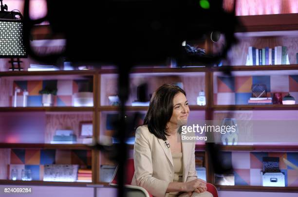 Sheryl Sandberg chief operating officer of Facebook Inc listens during a Bloomberg Studio 10 television interview at Facebook headquarters in Menlo...