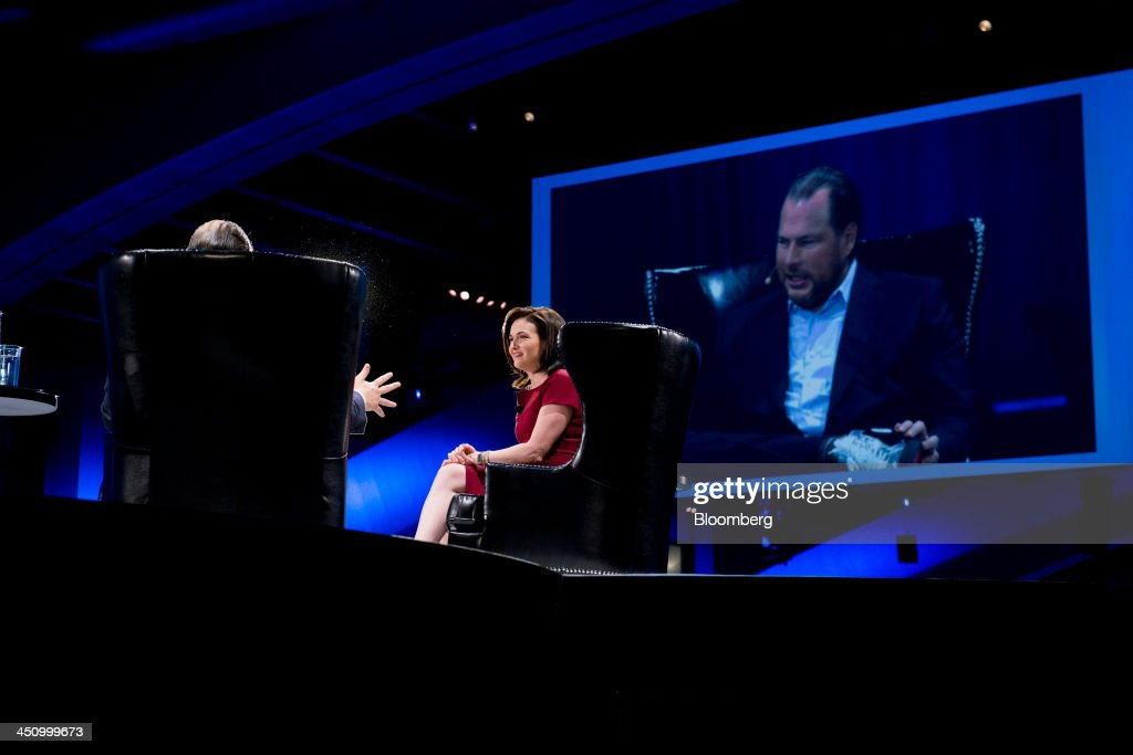 Sheryl Sandberg, chief operating officer of Facebook Inc., right, speaks with Marc Benioff, chairman and chief executive officer of Salesforce.com Inc., during the DreamForce Conference in San Francisco, California, U.S., on Wednesday, Nov. 20, 2013. Salesforce.com Inc. introduced an overhauled version of its mobile software, seeking to ensure clients and partners will be able to use more features of the company's sales, marketing and customer service software. Photographer: David Paul Morris/Bloomberg via Getty Images