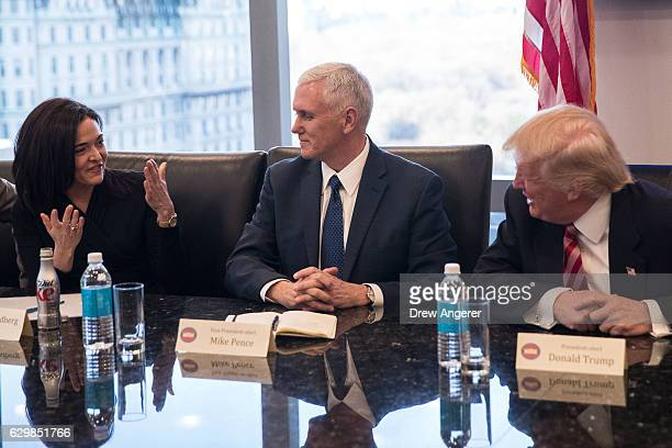 Sheryl Sandberg chief operating officer of Facebook speaks as Vice Presidentelect Mike Pence and Presidentelect Donald Trump listen during a meeting...