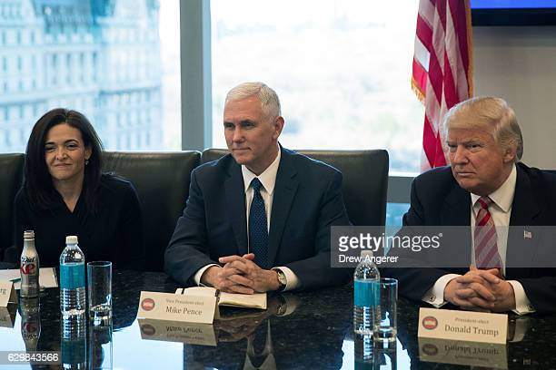 Sheryl Sandberg chief operating officer of Facebook Vice Presidentelect Mike Pence and Presidentelect Donald Trump listen during a meeting of...