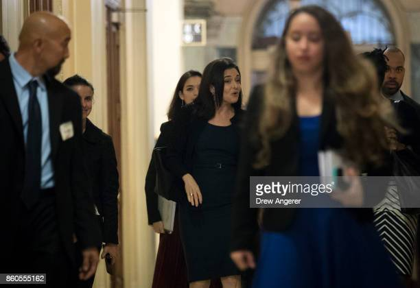 Sheryl Sandberg chief operating officer of Facebook walks to a meeting with members of the Congressional Black Caucus at the US Capitol October 12...