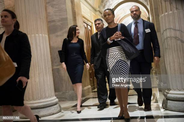 Sheryl Sandberg chief operating officer of Facebook walks with Rep Tony Cardenas on their way to a meeting with members of the Congressional Black...