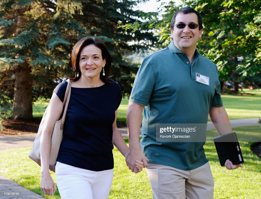 <a gi-track='captionPersonalityLinkClicked' href=/galleries/search?phrase=Sheryl+Sandberg&family=editorial&specificpeople=5922850 ng-click='$event.stopPropagation()'>Sheryl Sandberg</a>, COO of Facebook, and her husband <a gi-track='captionPersonalityLinkClicked' href=/galleries/search?phrase=David+Goldberg+-+CEO+f%C3%B6r+Surveymonkey&family=editorial&specificpeople=14572741 ng-click='$event.stopPropagation()'>David Goldberg</a> arrive for morning session of the Allen & Co. annual conference at the Sun Valley Resort on July 10, 2013 in Sun Valley, Idaho. The resort is hosting corporate leaders for the 31st annual Allen & Co. media and technology conference where some of the wealthiest and most powerful executives in media, finance, politics and tech gather for weeklong meetings. Past attendees included Warren Buffett, Bill Gates and Mark Zuckerberg.