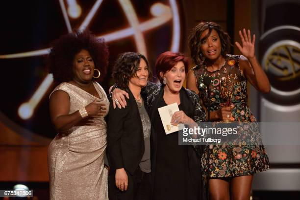 Sheryl Underwood Sara Gilbert Sharon Osbourne and Aisha Tyler accept the award for outstanding entertainment talk show host at the 44th annual...
