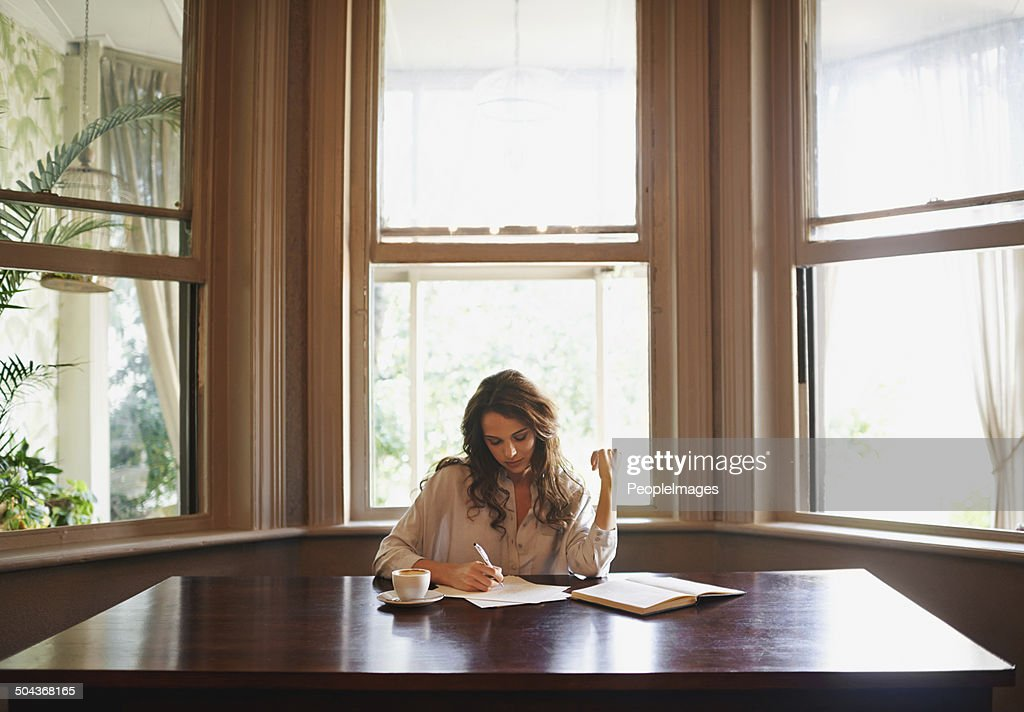 She's always writing : Stock Photo