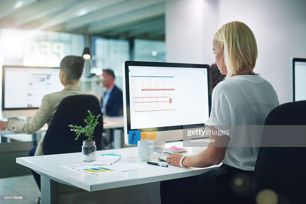 She's focused on the task at hand : Stock Photo