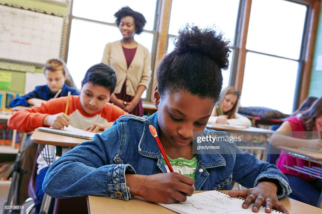 She's one focused student : Stock Photo