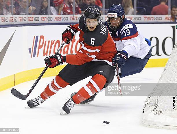 Shes Theodore of Team Canada tries to avoid a checking Radovan Bondra of Team Slovakia during a semifinal game in the 2015 IIHF World Junior Hockey...