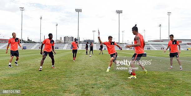 Sheyi Ojo Cameron Brannagan Roberto Firmino and Philippe Coutinho of Liverpool during a training session at St Louis University on August 1 2016 in...