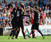 Sheyi Ojo of Liverpool celebrates after scoring the second for Liverpool during a preseason friendly at County Ground on August 2 2015 in Swindon...