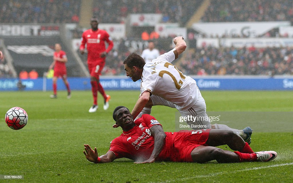 <a gi-track='captionPersonalityLinkClicked' href=/galleries/search?phrase=Sheyi+Ojo&family=editorial&specificpeople=12319409 ng-click='$event.stopPropagation()'>Sheyi Ojo</a> of Liverpool is challenged by Angel Rangel of Swansea City during the Barclays Premier League match between Swansea City and Liverpool at The Liberty Stadium on May 1, 2016 in Swansea, Wales.