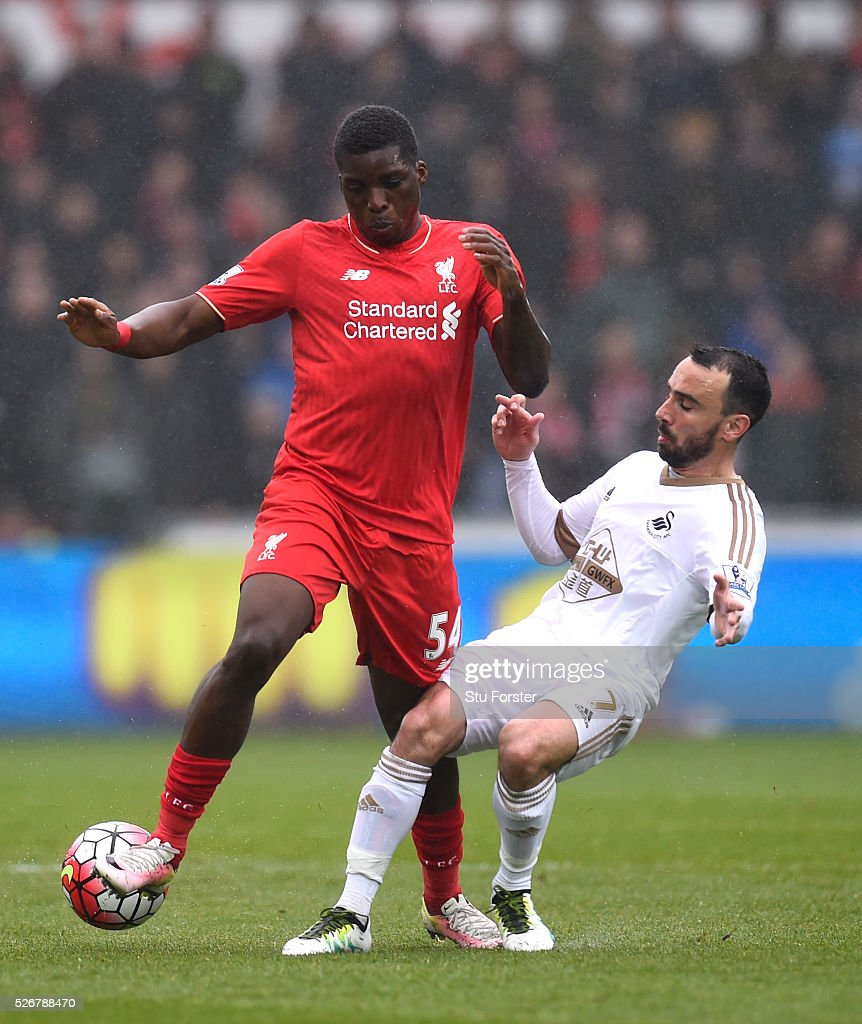 <a gi-track='captionPersonalityLinkClicked' href=/galleries/search?phrase=Sheyi+Ojo&family=editorial&specificpeople=12319409 ng-click='$event.stopPropagation()'>Sheyi Ojo</a> of Liverpool is tackled by <a gi-track='captionPersonalityLinkClicked' href=/galleries/search?phrase=Leon+Britton+-+Soccer+Player&family=editorial&specificpeople=12884689 ng-click='$event.stopPropagation()'>Leon Britton</a> of Swansea City during the Barclays Premier League match between Swansea City and Liverpool at The Liberty Stadium on May 1, 2016 in Swansea, Wales.