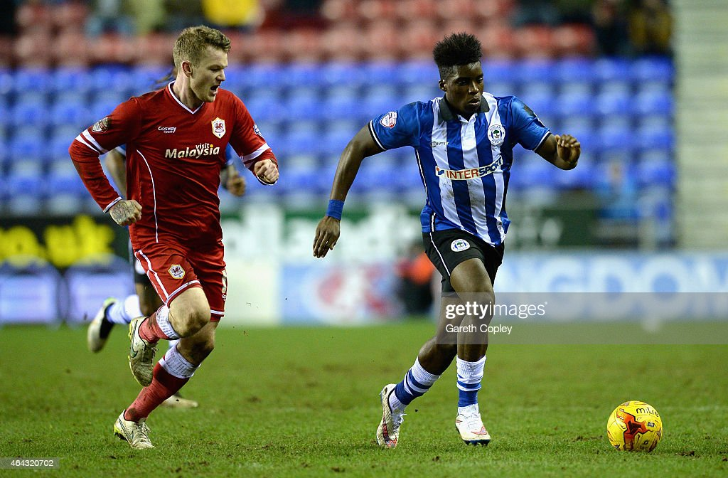 Sheyi Ojo of Wigan Athletic gets past Aron Gunnarsson of Cardiff City during the Sky Bet Championship match between Wigan Athletic and Cardiff City...