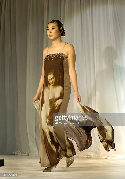 Shi Hyun Ahn models an Andre Kim gown on the fashion runway at the 2006 SBS Open at Turtle Bay February 14 at Kahuku Hawaii