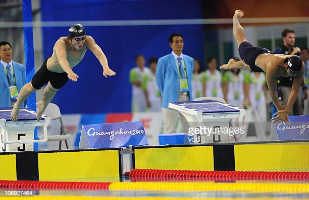 Shi Tengfei of China and Takuro Fujii of Japan compete in the Men's 100m Freestyle final at the Aoti Aquatics Centre during day five of the 16th...