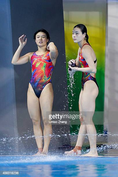 Shi Tingmao and Wu Minxia of China looks on competes in the Women's Synchronised 3m Springboard Final in day ten during the 2014 Asian Games at...