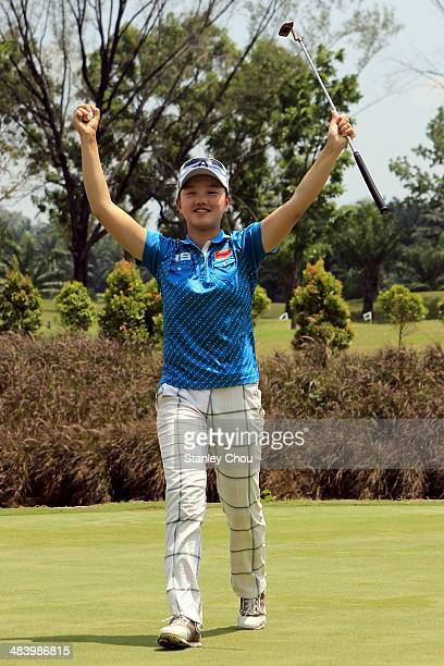 Shi Yuting of China celebrates on the 18th hole during day three stroke play of the Queen Sirikit Cup of Golf on April 11 2014 in Kuala Lumpur...