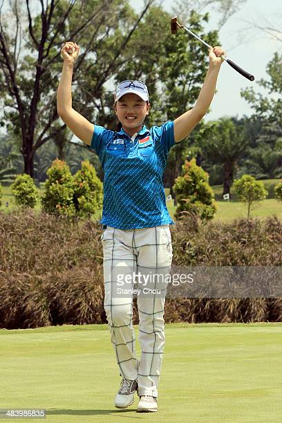 Shi Yuting of China celebrates on the 18th hole during day three stroke play of the Queen Sirikit Cup of Golf on April 11 2014 at the Saujana Golf...