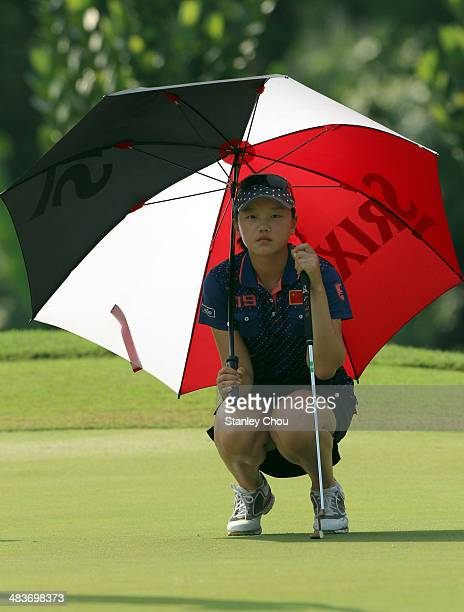 Shi Yuting of China lines up for a putt on the 4th hole during day two stroke play of the Queen Sirikit Cup of Golf at the Saujana Golf and Country...