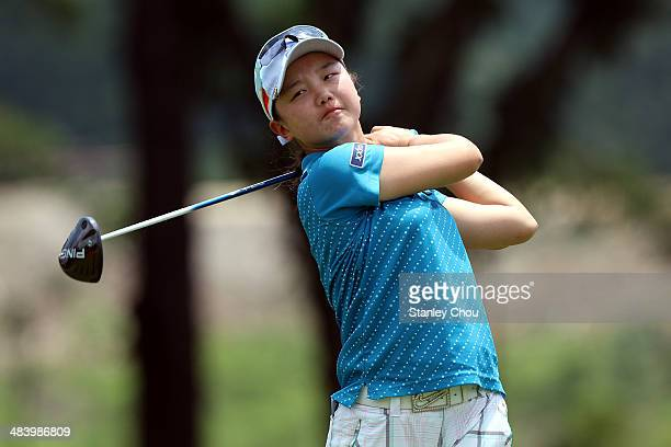 Shi Yuting of China plays her tee shot on the 18th hole during day three stroke play of the Queen Sirikit Cup of Golf on April 11 2014 at the Saujana...