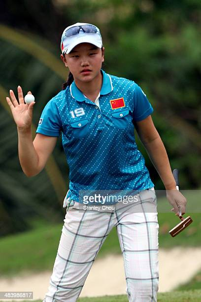Shi Yuting of China reacts on the 16th hole during day three stroke play of the Queen Sirikit Cup of Golf on April 11 2014 at the Saujana Golf and...