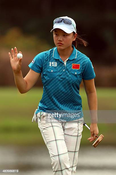 Shi Yuting of China reacts on the 17th hole during day three stroke play of the Queen Sirikit Cup of Golf on April 11 2014 at the Saujana Golf and...